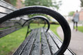 Park bench after rain closeup of with water drops storm Royalty Free Stock Photo