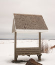 Park bench with roof during winter cloudy sky Royalty Free Stock Photography