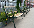 Park benches black along walkway Royalty Free Stock Photo