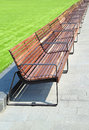 Park benches in a row Royalty Free Stock Photos