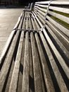 Park benches in the sun city square Royalty Free Stock Photo