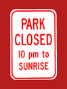 Park closed sign a bold pm to sunrise on a red background Royalty Free Stock Photography