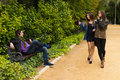 Park flirt young women flirting with a guy on a bench Royalty Free Stock Photography