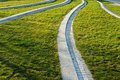 Park paths green grass and stone footpaths in Royalty Free Stock Photo