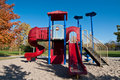 Park with Playground Equipment in Autumn Royalty Free Stock Photography