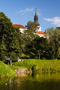 Park with pond in old european city Stock Photo