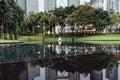 Park and pool under Petronas twin towers in Kuala Lumpur, Malaysia Royalty Free Stock Photo