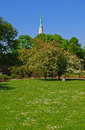 A Park in Riga during Summer Time with the tall Freedom Monument at the back Royalty Free Stock Photo