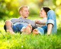Park young couple lying grass outdoor Stock Photos