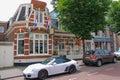 Parked autos in front of the picturesque vintage building zandvoort netherlands june zandvoort aan zee is a major sea resort Stock Photo