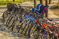Parked bikes in the park waiting for rent Royalty Free Stock Image