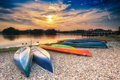 Parked Canoes by the lake at Sunset Royalty Free Stock Photo