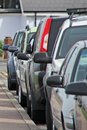 Parked cars and mirrors photo of by kerb row of wing Royalty Free Stock Photos