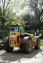 Parked jcb digger ready for work Stock Photography
