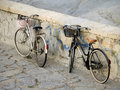 Parked ladies bicycles by stone wall Stock Photo