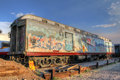Parked train car wreck with grafity in the santa fe train statio sprayed grafitty station is damaged and inoperational Royalty Free Stock Photos