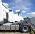 Parked trucks row of white Stock Image