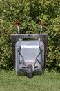 Parked Wheelbarrow on Lawn Royalty Free Stock Photo