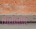 Parking for bicycles empty bike pink Stock Image