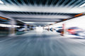 Parking garage interior with a few parked cars motion blur Stock Photo