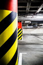 Parking garage underground interior concrete grunge industrial lot and column with warning sign industrial Royalty Free Stock Photos