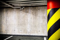 Parking garage underground interior concrete grunge wall and column with warning sign industrial Royalty Free Stock Photography