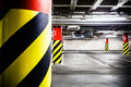 Parking garage underground interior concrete grunge wall and column with warning sign industrial Royalty Free Stock Image