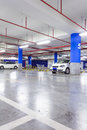 Parking garage underground interior with a few parked cars Royalty Free Stock Image
