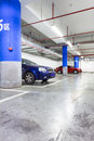 Parking garage underground interior with a few parked cars Royalty Free Stock Images