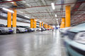 Parking garage underground interior with a few parked cars Stock Photography