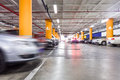 Parking garage underground interior with a few parked cars Royalty Free Stock Photo