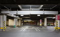 Parking garage underground interior neon lights in dark Royalty Free Stock Images