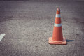 Parking lot with traffic cone on street used warning sign Royalty Free Stock Photo