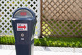 Parking Meter Expired in Front of Fence Royalty Free Stock Photo