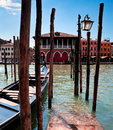 Parking place for gondolas in venice view of on grand canal italy Royalty Free Stock Photo