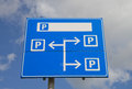 Parking sign blue multiple outside under a blue cloudy sky Royalty Free Stock Photo