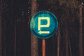 Parking sign in the wood with the index on left. Royalty Free Stock Photo