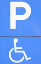 Parking space sign blue handicap or wheelchair Stock Image