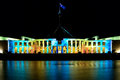 Parliamenet house at enlighten australias parliament is lit up for festival in canberra australia Stock Photo
