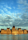 The parliament in budapest hungarian and danube river at sunset against beautiful cloudscape Stock Photo