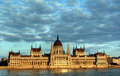 The parliament in budapest hungarian and danube river at sunset against beautiful cloudscape Stock Images