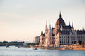 The parliament building in budapest capital of hungary overlooking river danube just before sunset Stock Photos