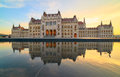 Parliament building in budapest on a sunset with reflection fountain Stock Photo