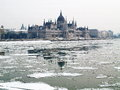 Parliament of hungary and the river of danube icey Royalty Free Stock Photography