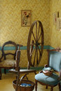 Parlour and antique spinning wheel Royalty Free Stock Photos