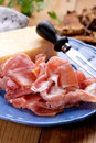 Parma ham on the plate and parmesan cheese blue Royalty Free Stock Photos