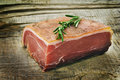 Parma ham with rosemary on a wooden board Stock Image