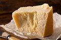 Parmesan cheese an aged authentic parmigiano reggiano with wrapper and knife Royalty Free Stock Images