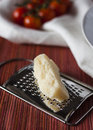 Parmesan cheese a little bit of on a grater Royalty Free Stock Photos