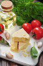 Parmesan cheese with tomatoes and basil on wooden background Stock Image
